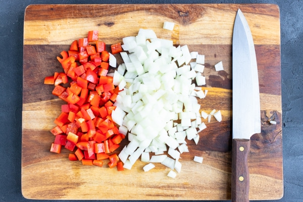 Diced onion and bell peppers for a gallo pinto recipe.