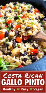 Black beans, rice, red bell peppers, and cilantro in a black skillet.