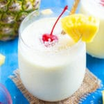 An easy homemade piña colada in a serving glass.