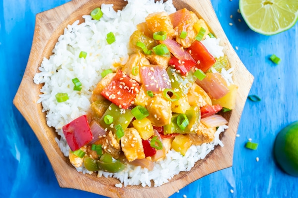 Easy pineapple chicken recipe with bell peppers, onions, and a sticky sauce.
