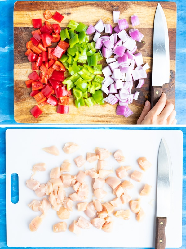 Bell peppers, red onion, and chicken cut into 1-inch cubes for a showing how to make a pineapple chicken recipe.