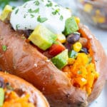Taco stuffed sweet potatoes with black beans and corn for a vegan dinner recipe.