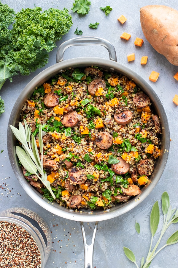 A one-pot dinner meal idea for sweet potatoes, quinoa, sausage, and kale.