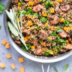 A Fall-inspired healthy quinoa recipe with sage, sweet potatoes, chicken apple sausage, and kale.