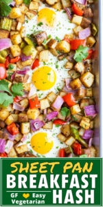 Roasted breakfast potatoes with bell peppers, onions, and eggs on a sheet pan.