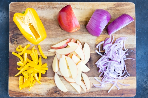 Red onion, bell pepper, and sliced apple for a Fall salad recipe.