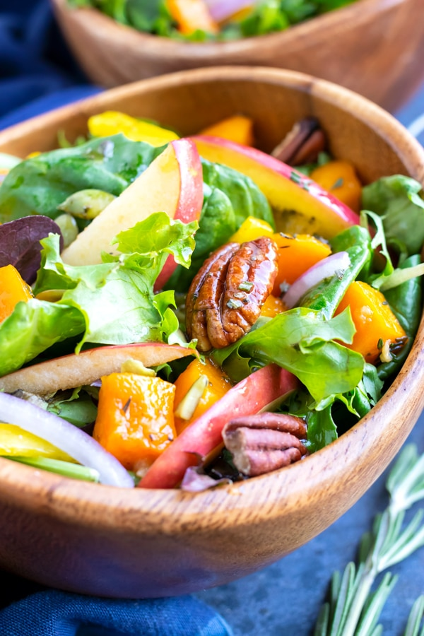 Mixed greens with pecans, apples, and butternuts squash topped with an apple cider vinaigrette salad dressing.