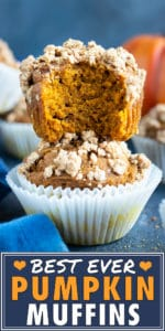 Two healthy pumpkin muffins stacked on top of each other with a pumpkin in the background.