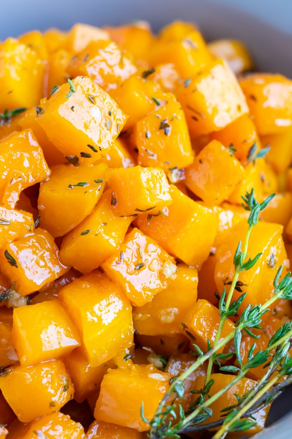 A close-up image of roasted butternut squash that has been cut into cubes and baked in the oven at 400 degrees.