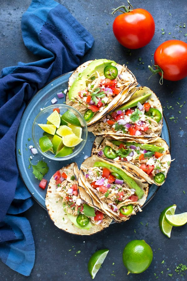 Learn how to make shredded chicken tacos in either the Instant Pot or the Crock-Pot.
