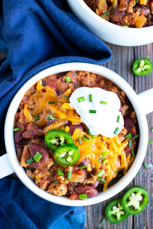 A big bowl full of healthy ground turkey chili that is made in a pressure cooker.