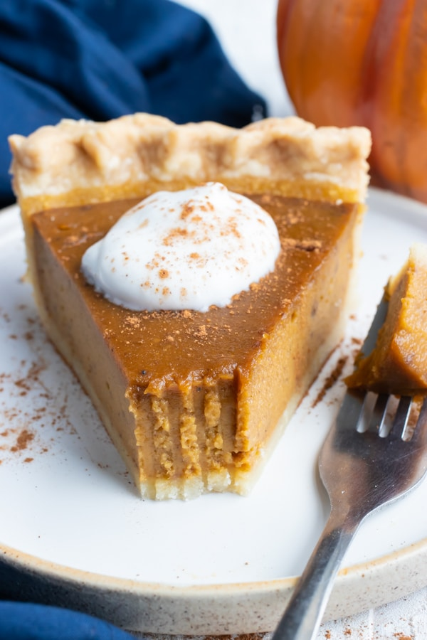 A creamy, pumpkin pie spiced filling with a flaky and buttery pie crust for a Thanksgiving dessert recipe.