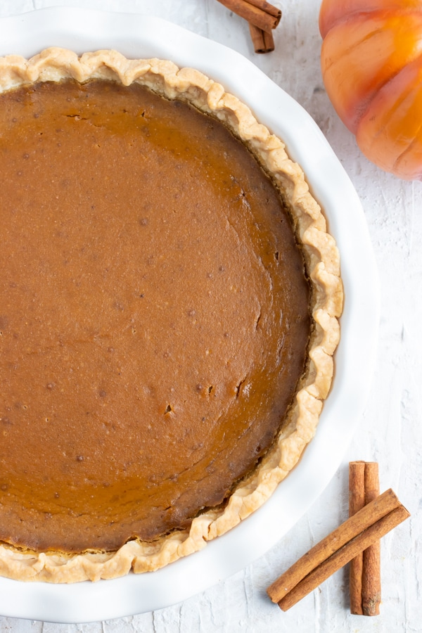 A 9-inch homemade pie crust full of a creamy, dairy-free, gluten-free, and vegan pumpkin pie filling.