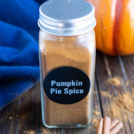 A spice jar full of DIY pumpkin pie spice.
