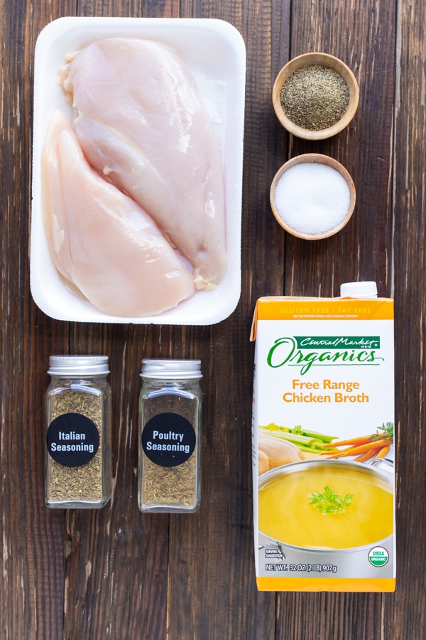 Chicken, salt, pepper, broth, and seasoning mixes as the ingredients for an easy shredded chicken recipe.