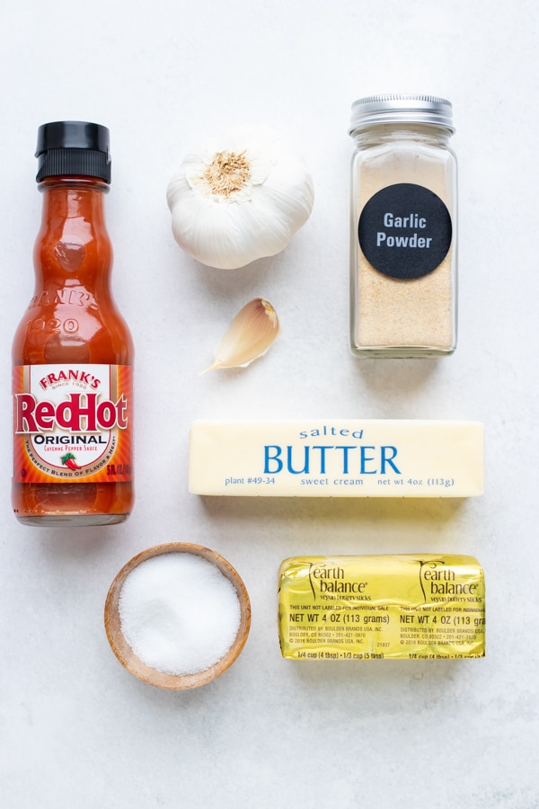 The four ingredients that are needed to make a homemade buffalo sauce recipe: hot sauce, butter, garlic, and salt.