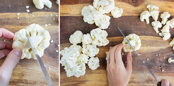 Chopping up large cauliflower florets into smaller florets.