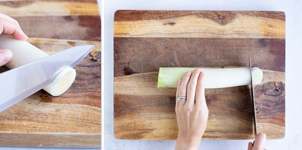 A cutting board with a fresh leek on it and cutting it into round slices.