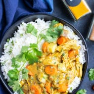 Instant Pot Chicken curry that is served on a bed of basmati rice.