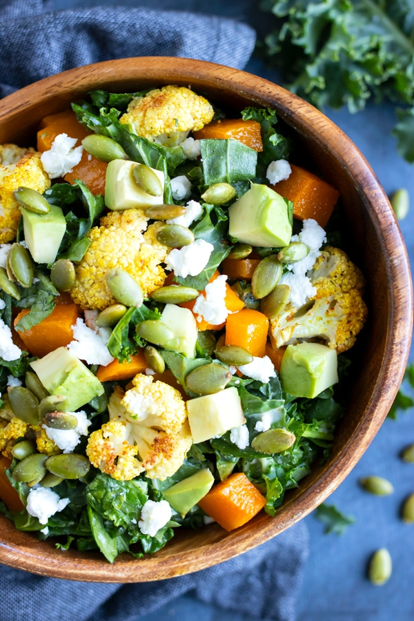 A roasted vegetable salad recipe with kale and cauliflower.