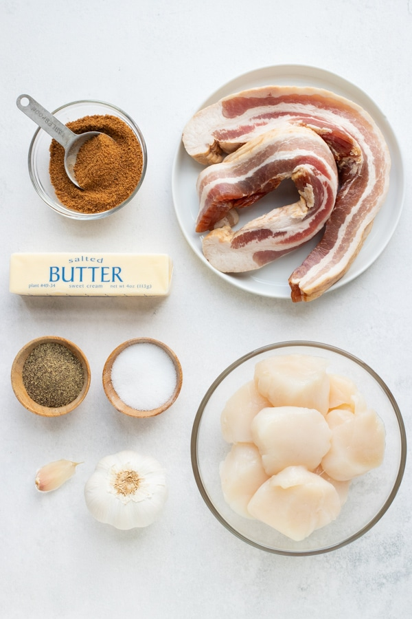 Bacon, brown sugar, butter, garlic, and sea scallops as the ingredients for a bacon wrapped scallops recipe.