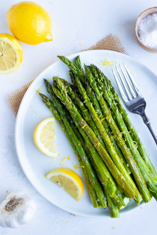 A healthy Spring and Easter side dish recipe for lemon garlic roasted asparagus.