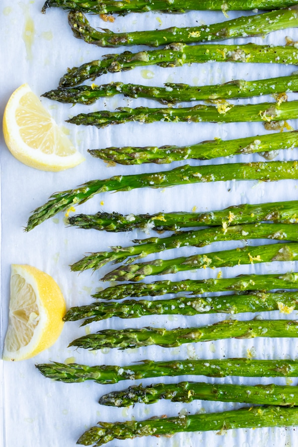 Low-carb, vegan, and Whole30 asparagus side dish recipe with lemon, garlic and oil.