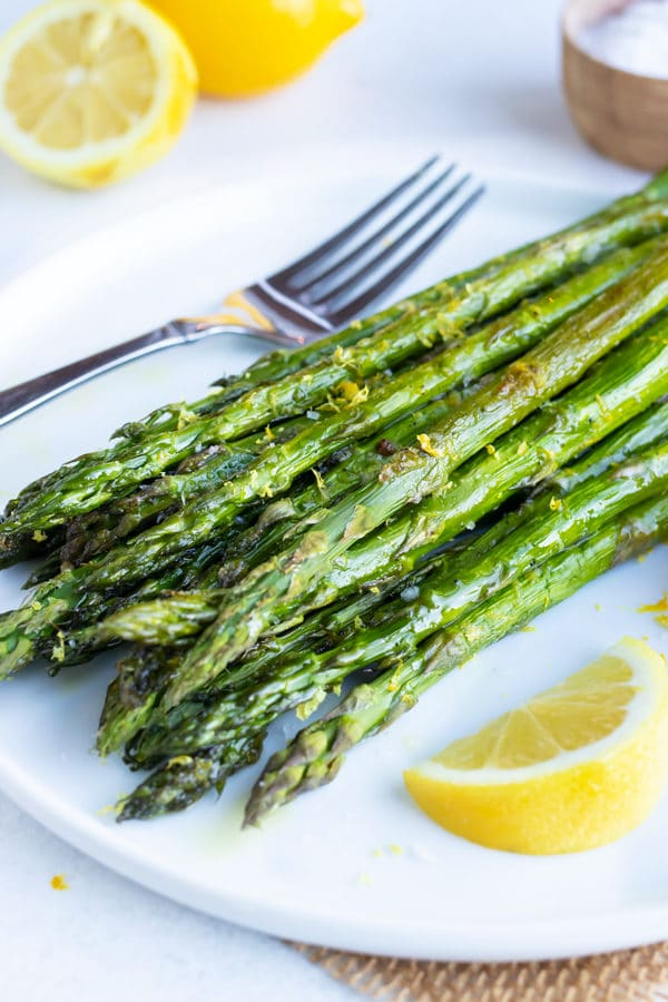 A quick, healthy, and easy side dish recipe for roasted asparagus with a lemon garlic sauce.