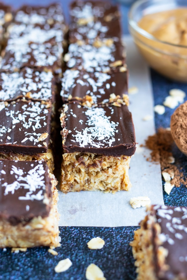 Healthy, vegan, and gluten-free, chocolate peanut butter oatmeal bars with shredded coconut.