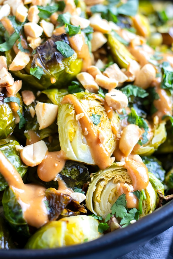 Crispy Brussels sprouts that have been roasted in the oven and drizzled with a creamy Asian sauce.