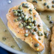 Easy Chicken Piccata with capers and a creamy lemon butter sauce in a skillet.