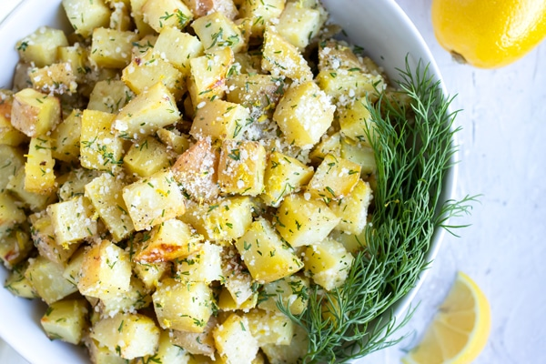 Parmesan roasted potatoes with lemon zest and fresh dill.