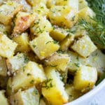 An easy vegan and Whole30 potato side dish recipe with lemon, dill, and butter sauce.