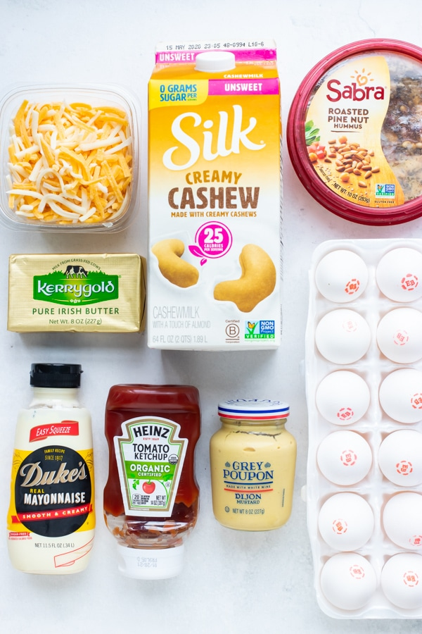 Milk, eggs, cheese, butter, and condiments for refrigerator staples.