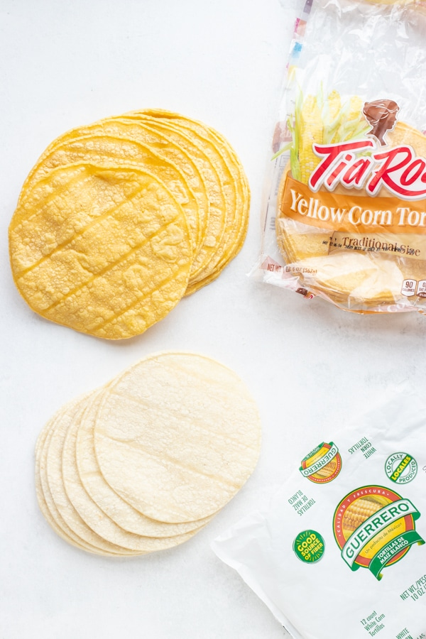 White corn tortillas and yellow corn tortillas.