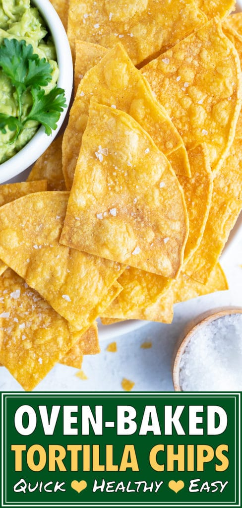 Yellow corn tortilla chips with sea salt next to Mexican avocado dip.