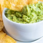 A chip being dipped into guacamole.