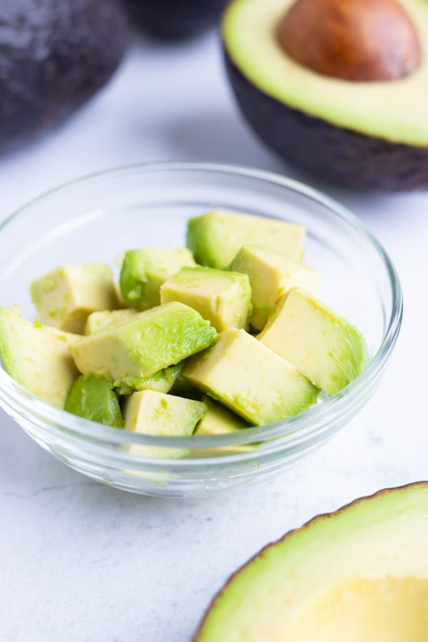 Avocado cubes in a clear class bowl.