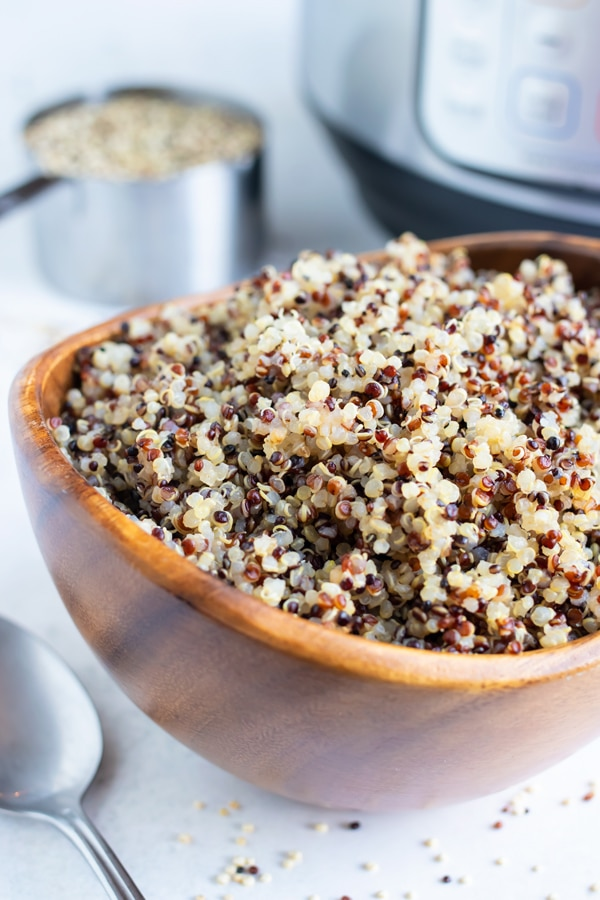 Fluffy quinoa that was cooked in an Instant Pot in a wooden bowl.