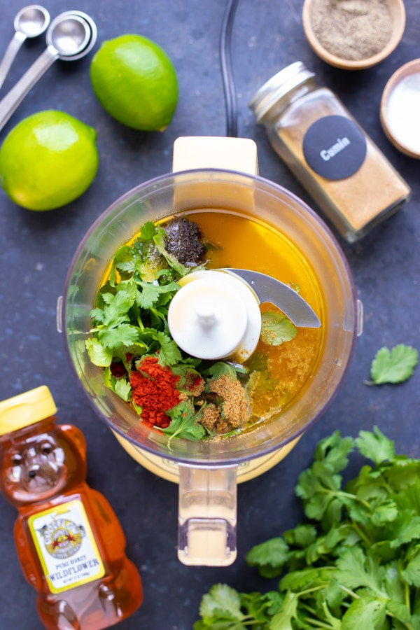 Cilantro, lime, and spices for a homemade salad dressing recipe.