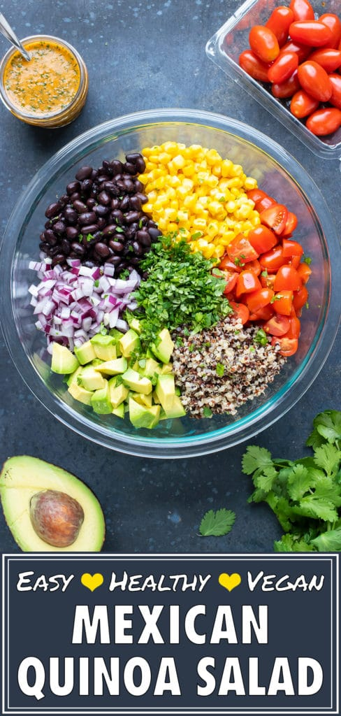 A Mexican Quinoa Salad with avocado in a clear glass bowl with a cilantro lime dressing.