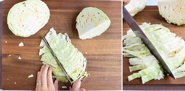 A knife cutting cabbage into thin 1-inch pieces.