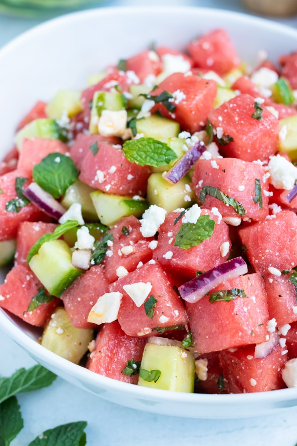 A quick, easy, and healthy watermelon fruit salad recipe with cucumber, feta cheese, and mint.