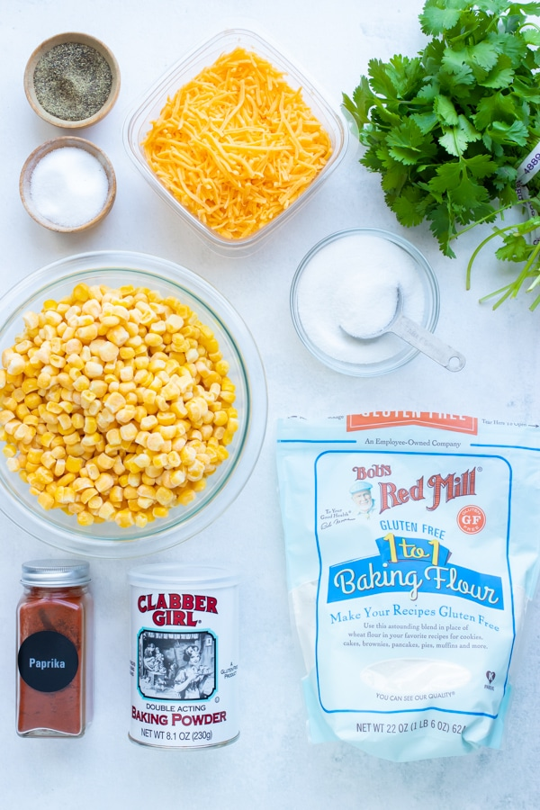 Corn, cheese, flour, cilantro, and Southern seasonings fried corn fritters recipe.