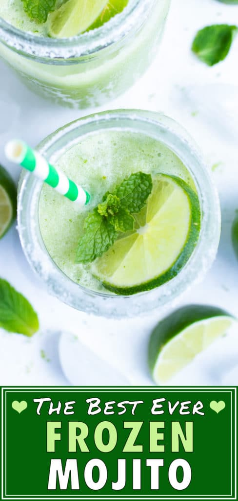 Two glasses of frozen mojito next to lime slices and mint.