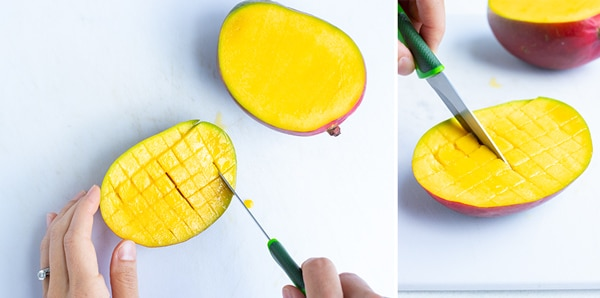 Cutting crosswise cuts to dice a mango.