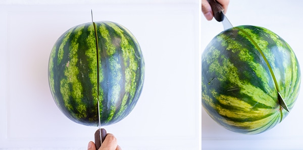 Cutting a personal-sized watermelon in half lengthwise.