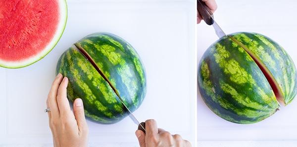 A knife cutting a watermelon half into quarters.