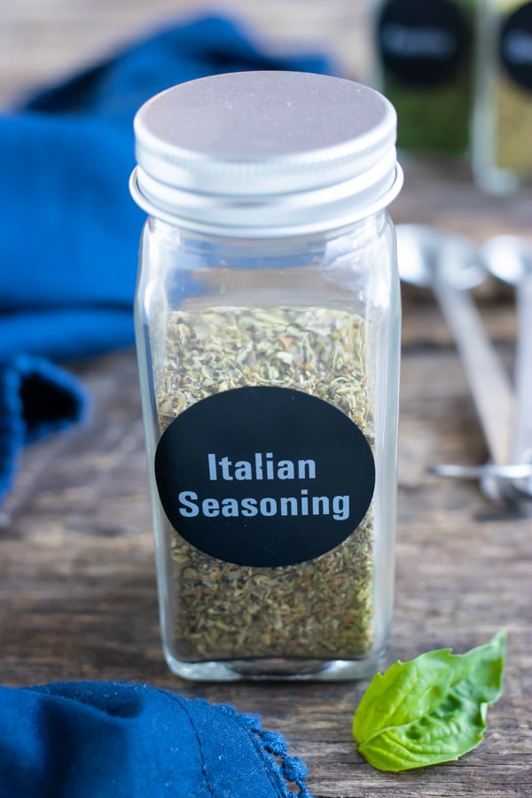 A spice jar storing a homemade Italian seasoning spice mix for a year or two.