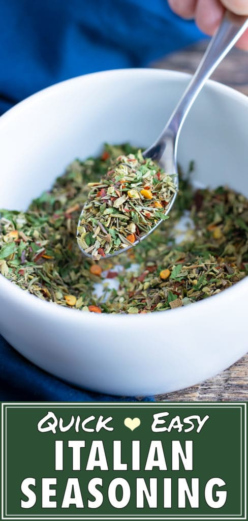 A spoon scooping out an easy Italian seasoning blend from a mixing bowl.